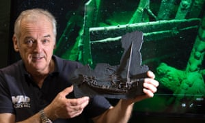 Professor Jon Adams of the Black Sea Maritime Archaeology Project holding a 3D model of a Greek ship from 400BC, officially the world's oldest intact shipwreck