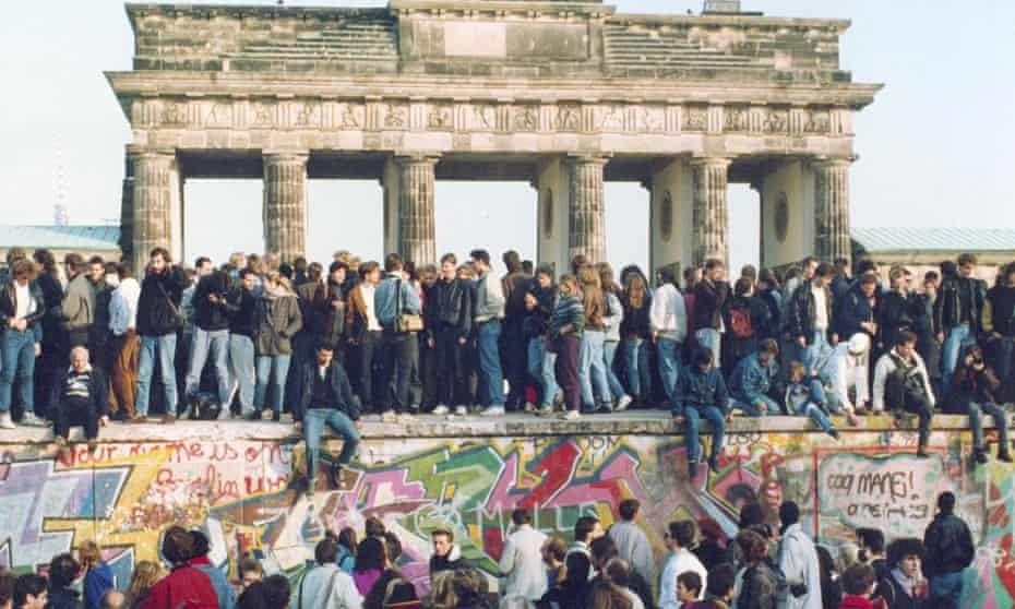 Bringing the haus down: a protest on top of the wall on the eve of its demolition.