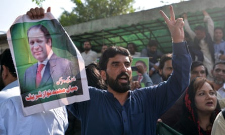 Nawaz Sharif supporters celebrate outside the high court in Islamabad.