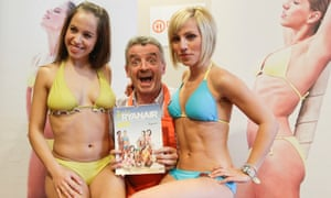 Michael O'Leary, chief executive of Ryanair, poses with cabin crew to promote the airline's annual charity calendar