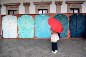 """Milan, ItalyA visitor views an installation called """"Tele in Camicia"""", five shades of blue by Ludovica Diligu with Labo at an exhibition at Milan University."""