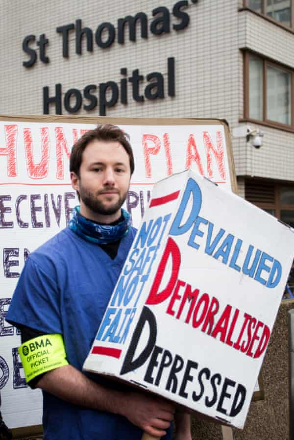 A doctor protests outside St Thomas' hospital in London. The BMA said junior doctors 'cannot and will not accept a contract that is bad for the future of patient care, the profession and the NHS'.