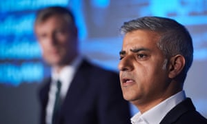Zac Goldsmith (left) and Sadiq Khan take part in a mayoral debate in central London on April 12, 2016.