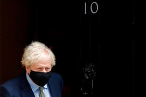 Britain's Prime Minister Boris Johnson wearing a face mask or covering due to the COVID-19 pandemic, leaves number 10 Downing Street in central London.