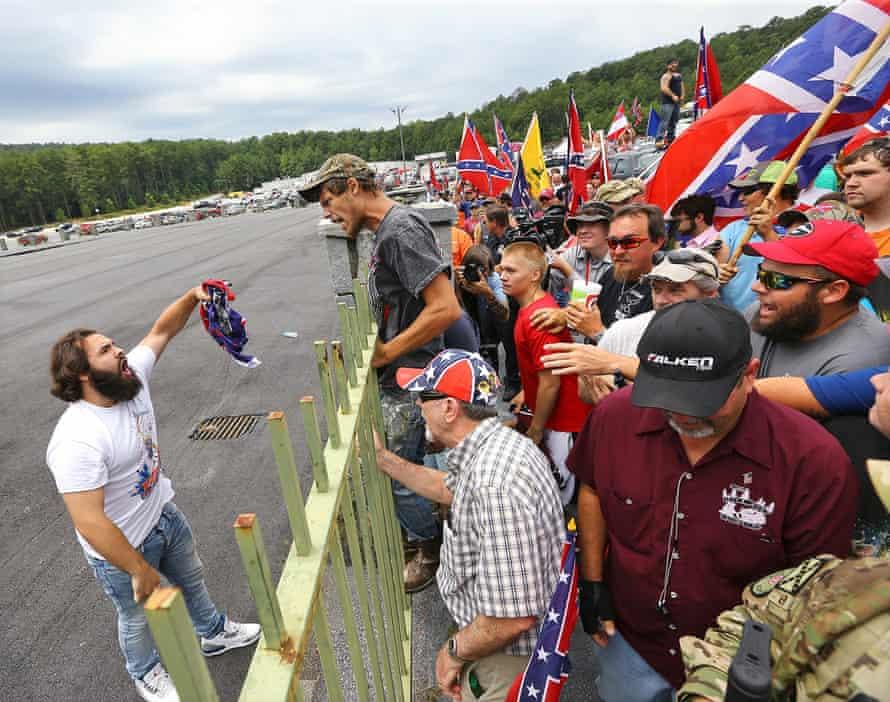 Tommy DiMassimo burns a Confederate flag
