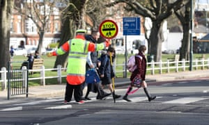Children and parents on a zebra crossing