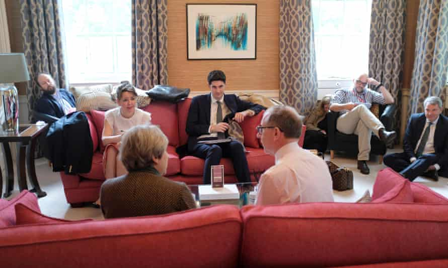 Theresa May with her husband Philip and advisers in their 10th floor, in the middle of a decoration discarded as