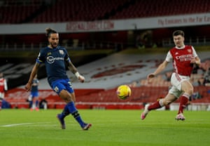 Theo Walcott scores with a deft lob.