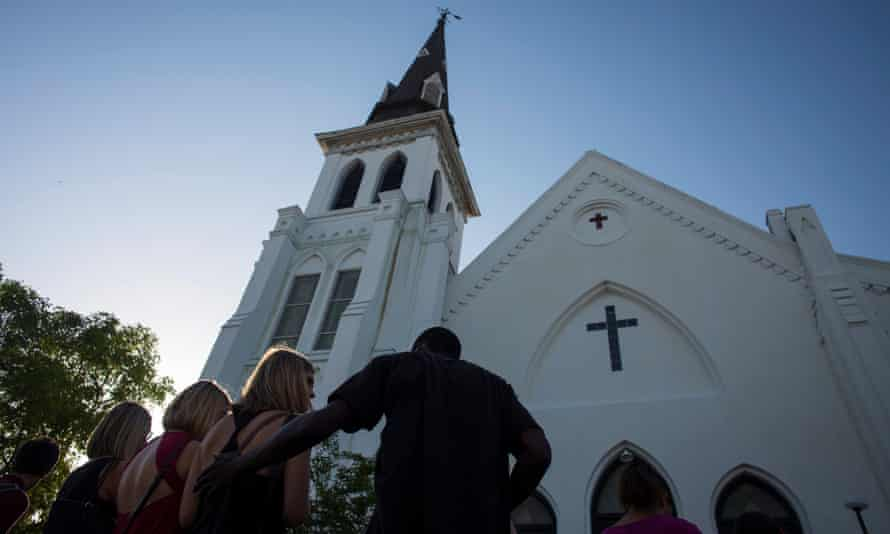 People comfort each other at a vigil outside the Emanuel church in Charleston, where nine black churchgoers were killed.