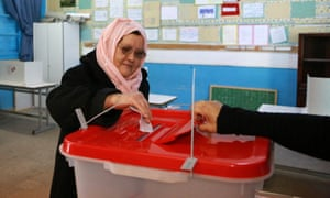 A woman votes in Tunisia's first democratic presidential election in 2014.