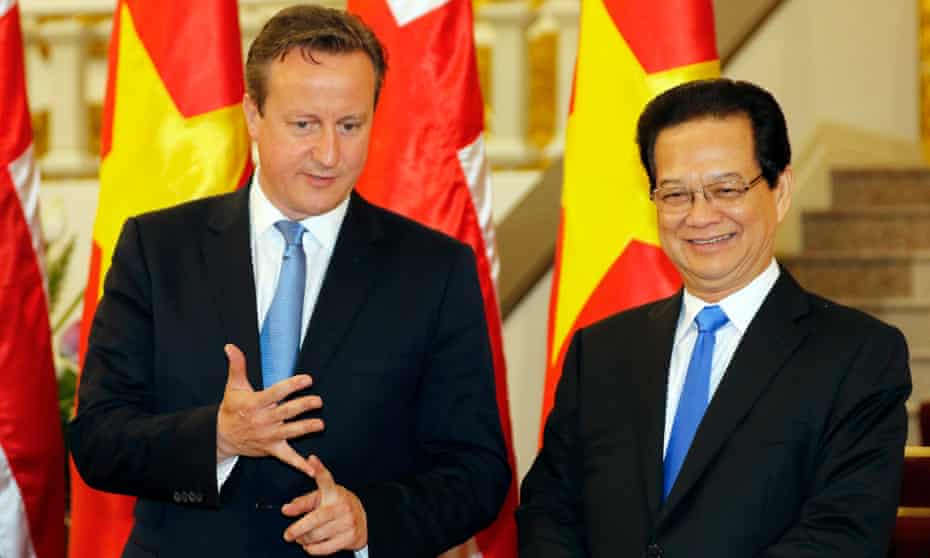 The British prime minister with his Vietnamese counterpart, Nguyễn Tấn Dũng, in Hanoi.
