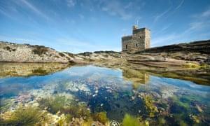 Portencross Castle reflected in a small rock pool