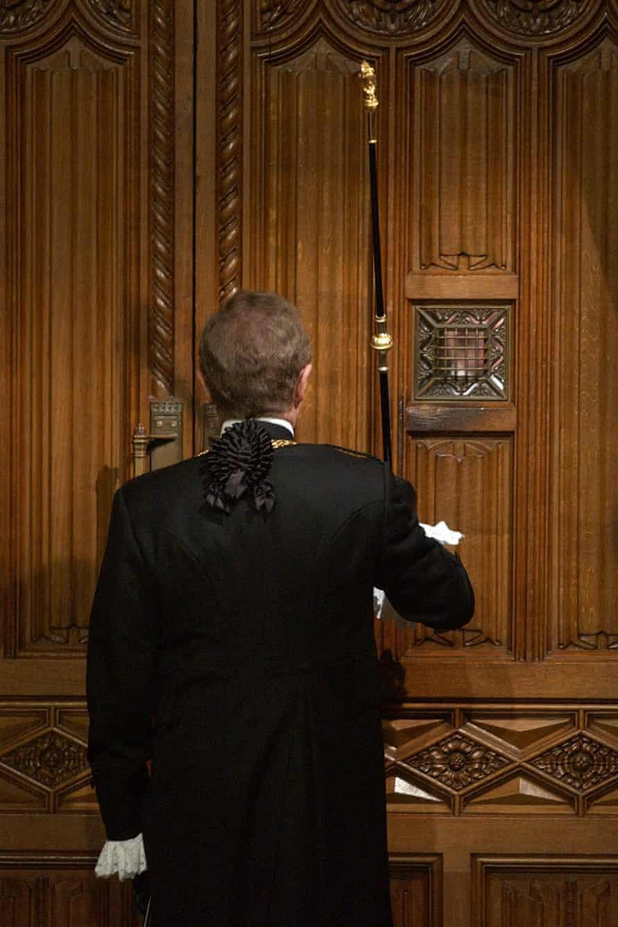 Black Rod hammers on the door of the House of Commons to invite MPs to proceed to the House of Lords to listen to the Queen's Speech.