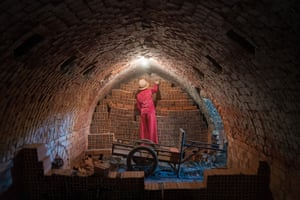 Leakena removes bricks that have been fired from inside the kiln
