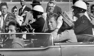 President John F Kennedy and Jacqueline Kennedy travelling in Dallas, Texas, in November 1963, moments before his assassination.