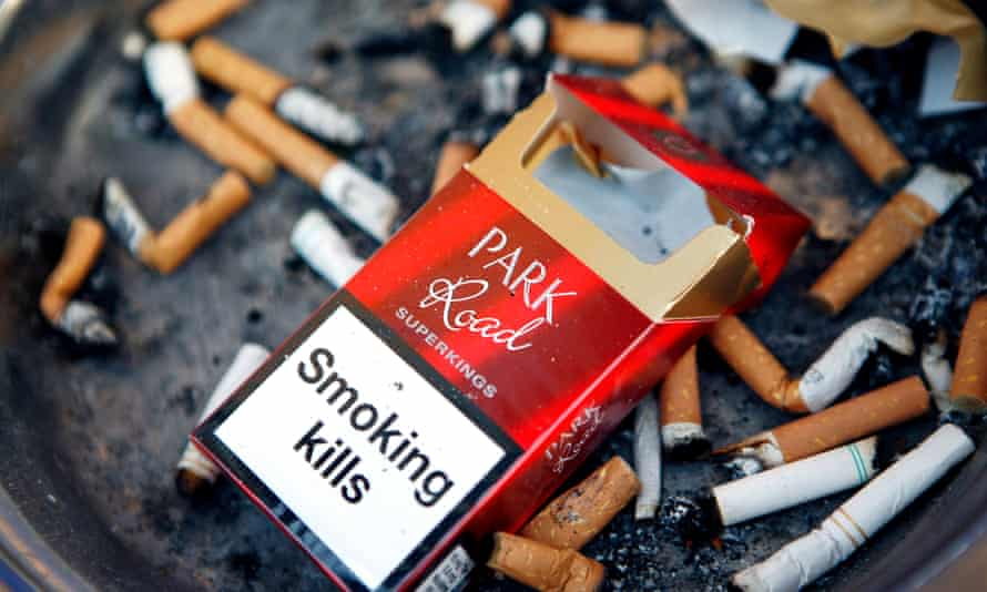 An empty cigarette packet among cigarette butts