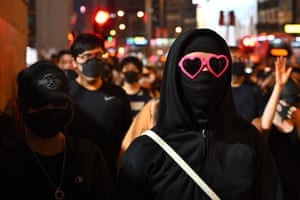 A protester wearing a mask and sunglasses in the Sham Shui Po district.