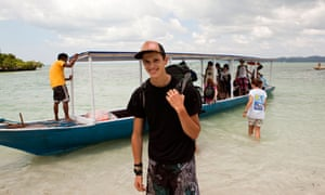 Young volunteer arriving on beach in Sulawesi, Indonesia
