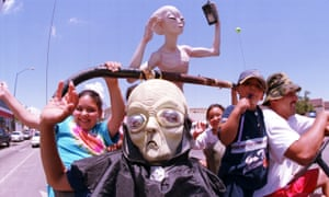 Aliens join the 2000 festival in Roswell, New Mexico, which celebrates the 1947 crashed balloon, first passed off by the army as a UFO.