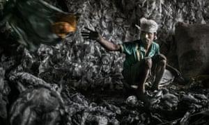 Worker at work beside Dhapa west dumping ground, Kolkata