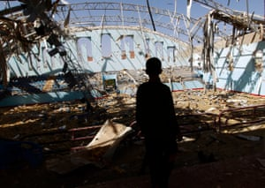 A Yemeni boy inspect the damage at a sports hall in Sana'a