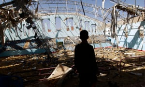 A Yemeni boy inspect the damage at a sports hall that was partially destroyed by Saudi-led airstrikes in Sana'a.