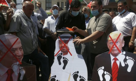 Palestinians shoes are placed on a pictures of Donald Trump, the UAE's Crown Prince Mohammed bin Zayed Al Nahyan and the Israeli prime minister, Benjamin Netanyahu, during a protest in the West Bank.