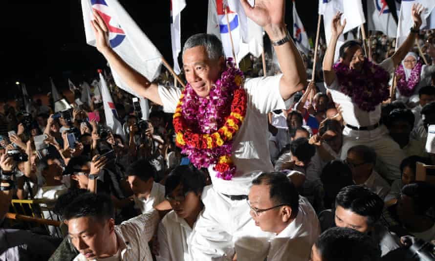 Singapore's prime minister Lee Hsien Loong, of the People's Action party, celebrates early results.