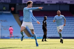 Manchester City's John Stones (left) celebrates scoring his team's second goal.