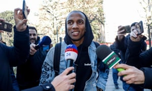 Ashley Young rocks up in Milan on Friday.