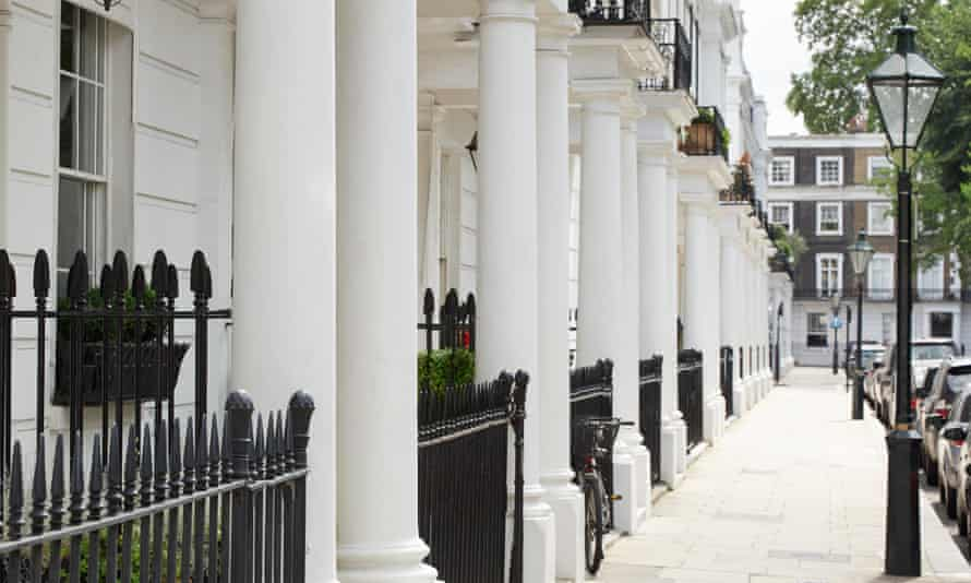A row of stucco-fronted Edwardian houses in Kensington, London.