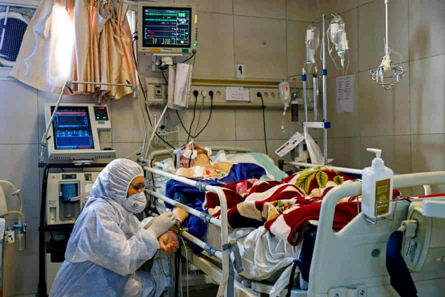 An Iranian medic treats a patient infected with the Covid-19 virus at a hospital in Tehran.