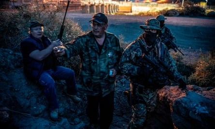 Members of the armed militia group United Constitutional Patriots patrolling the US-Mexico border in Sunland Park, New Mexico last month.