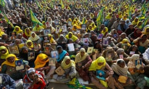 Women, including widows and relatives of farmers believed to have killed themselves over debt, protest against farm bills passed by India's parliament, at Tikri border near Delhi.