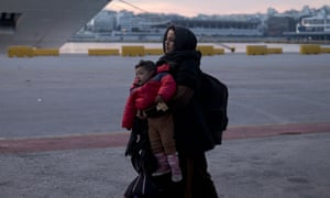 An Afghan woman arriving with her child in Athens' main port of Piraeus last week.