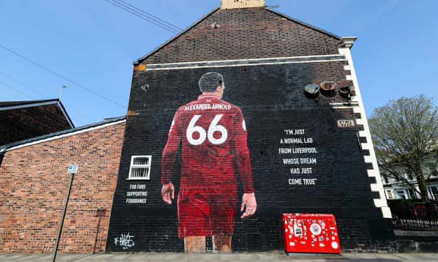 Large mural of Trent Alexander-Arnold on the wall of a house, with his back turned to show his number, 66, on his all-red strip, and the words 'I'm just a normal lad from Liverpool whose dream jst came true'