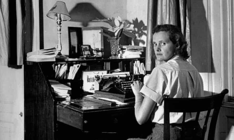 Du Maurier at her desk.