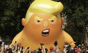 FILE - In this Friday, July 13, 2018 file photo a six-meter high cartoon baby blimp of U.S. President Donald Trump is flown as a protest against his visit, in Parliament Square in London, England. Trump is making his first trip to Britain as president after a tense summit with NATO leaders in Brussels and on the heels of ruptures in British Prime Minister Theresa May's government because of the crisis over Britain's exit from the European Union. (AP Photo/Matt Dunham, File)