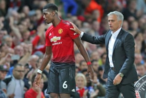 Jose Mourinho with Paul Pogba as the player was substituted against Leicester in August.