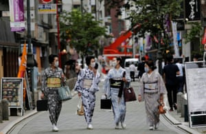 Maki, Mayu, Koiku and Ikuko, wear protective face masks as they walk to a restaurant after attending a dance class