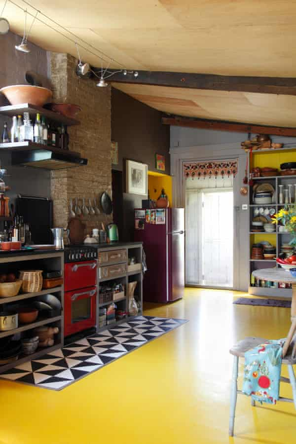 plywood ceilings and yellow rubber flooring in the kitchen