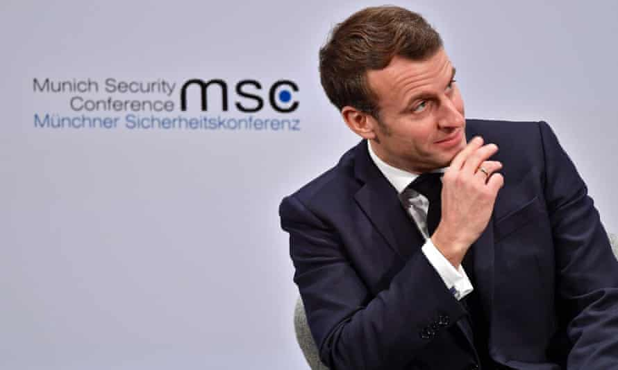 Emmanuel Macron gestures as he speaks at the 56th Munich Security Conference.