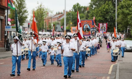 Orange Order members take part in a Twelfth of July parade in Belfast