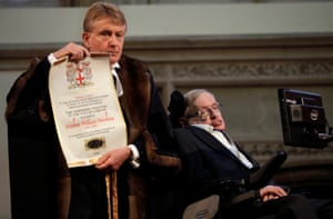 Stephen Hawking being presented with his illuminated freedom scroll by the chamberlain of the City of London, Peter Kane, in March 2017