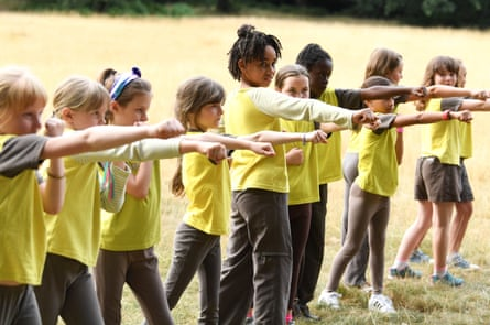 'The scout movement has moved with the times, and they're quite hip now' … Brownies exercising.