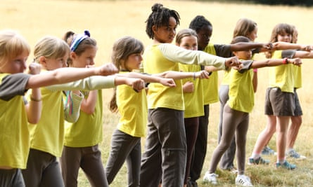 Guides and Brownies from the 22nd Walthamstow unit in London participate in triple boxing