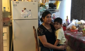 Dora Diaz and her son Gael in their apartment. They haven't yet faced eviction but fear it is coming.