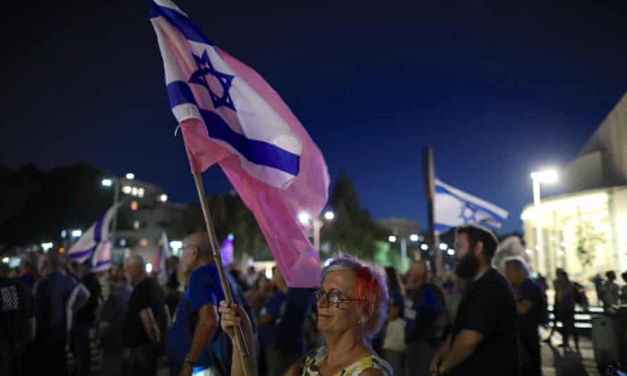 Israelis protest against Bennett's plan to form a coalition with Yair Lapid, in Tel Aviv.