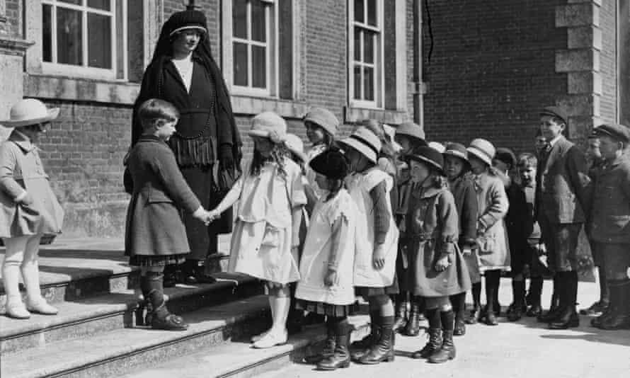 Convent school pupils queue to wish one of their classmates happy birthday.