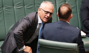 Malcolm Turnbull speaking with Tony Abbott during question time.